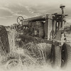 Old farm tractor outside Idaho Falls. HDR photo (Photomatix) converted to black and white in Nik Silver Effects Pro.