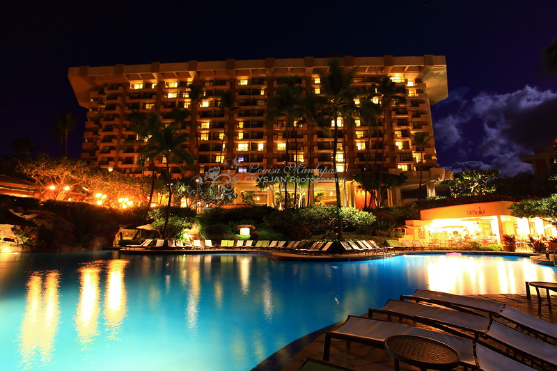Hyatt Regency & Spa Hotel at Night .  The full moon brings light to the clouds when you use a long shutter speed.