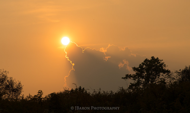 Setting Sun Held by Clouds