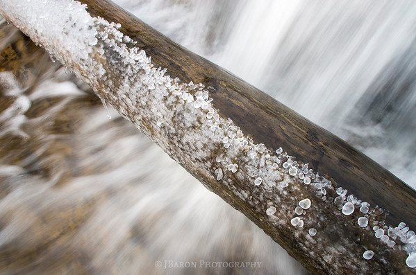 Frozen Log over a Waterfall