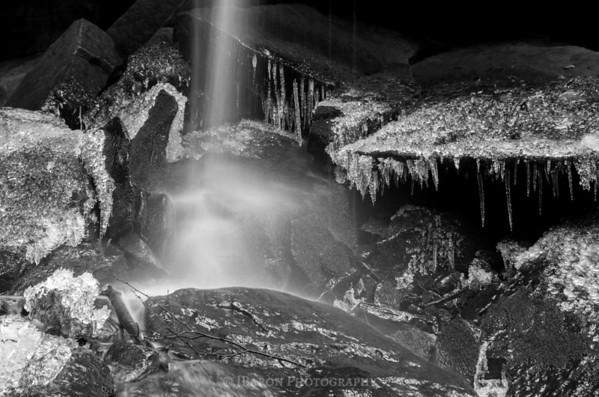 Narrow Flow of Eckert Falls On Icy Rocks