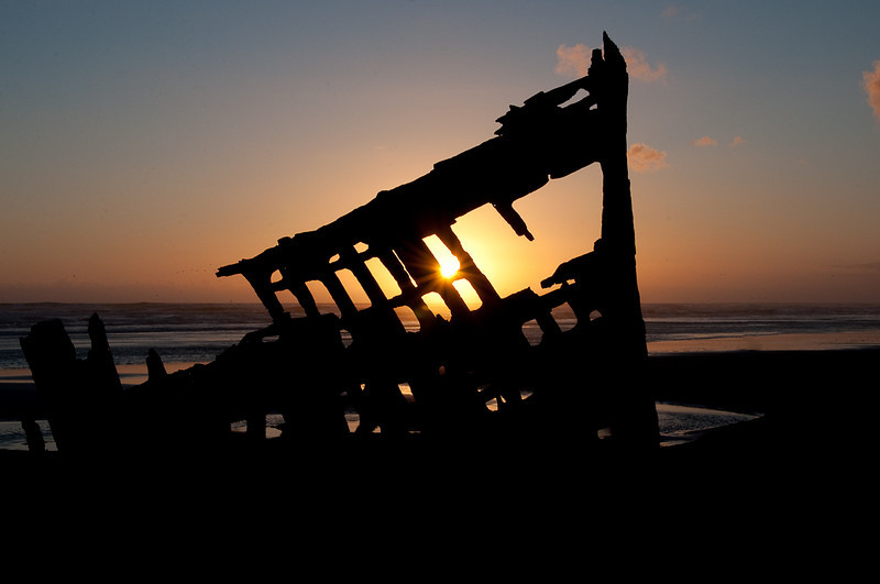 "Iredale at Sunset, 2010  The <a href=""http://en.wikipedia.org/wiki/Peter_Iredale#Wreck"">Peter Iredale</a> ran aground the Oregon coast off Astoria around September 26, 1906. This is what remains. The wreck is easily accessible at the beach in <a href=""http://en.wikipedia.org/wiki/Fort_Stevens_State_Park"">Fort Stevens State Park, Oregon</a>."