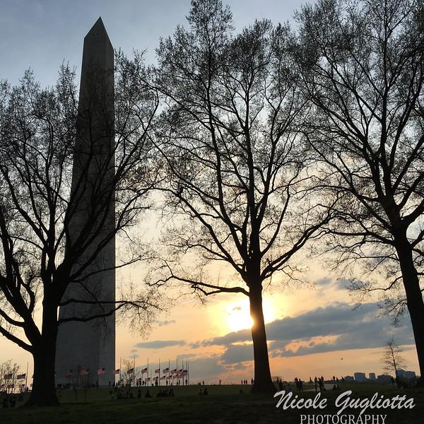 The sun sets on the Washington Monument