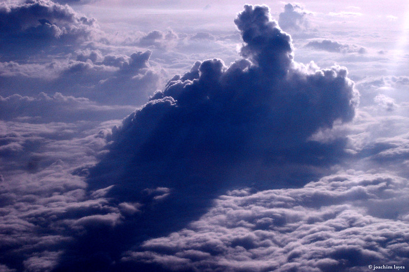 Dramatic view of clouds during flight from Japan to Hong Kong - 8