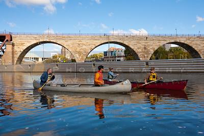 201001002-106 Canoes and Stone Arch bridge