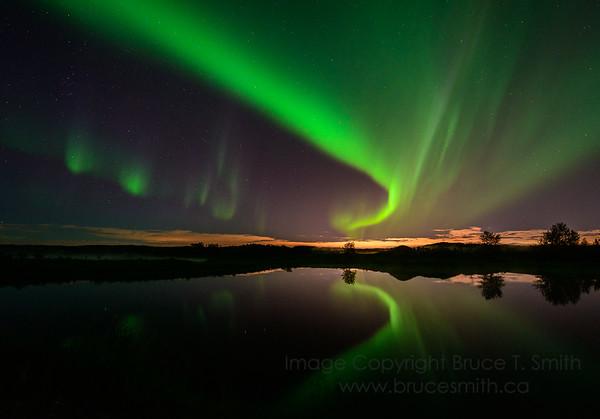 165 Aurora Borealis reflection and city glow