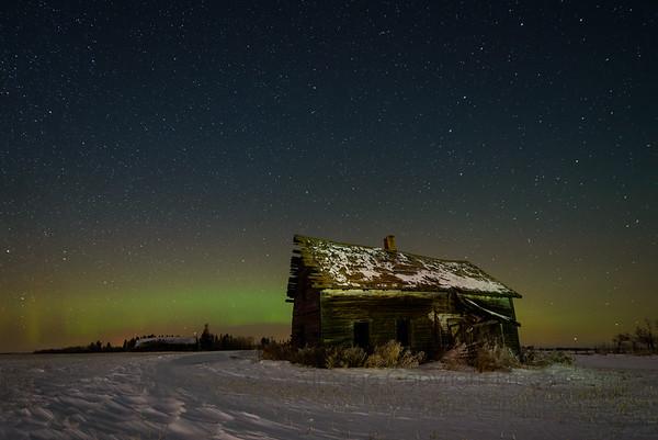 110 Winter Aurora Borealis and abandoned farmhouse