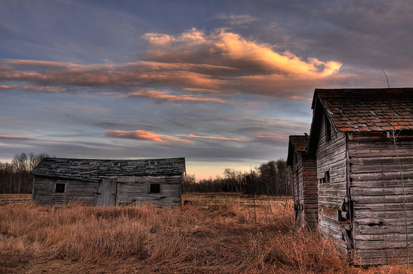 Abandoned Farm Buildings at Sunset