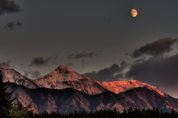Sunset glow and the moon over the mountains