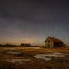 Abandoned farm and aurora