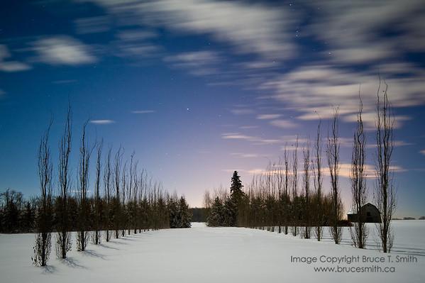 Old farm under a full moon