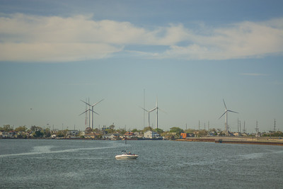 Wind Turbines , Waterfront Homes & a boat