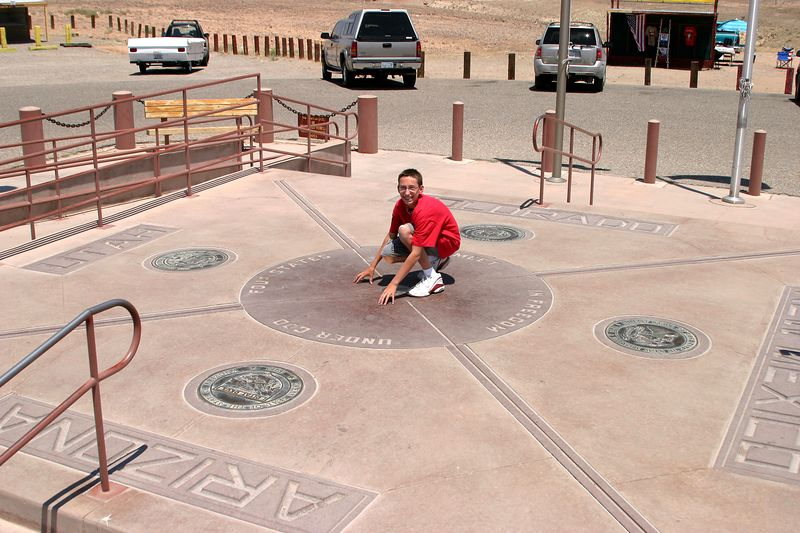 The Four Corners monument has certainly grown since last I was there (1972). I took the shot from a little platform overlooking the marker. Then I took out a spatula and scraped Tyler off the sizzling-hot pavement.