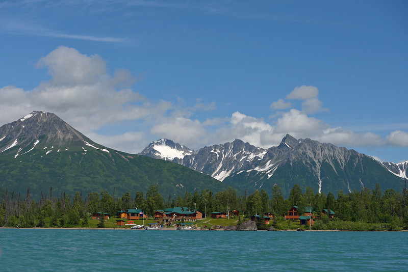 A view of the lodge showing its spectacular location nestled between the mountains and Crescent lake.