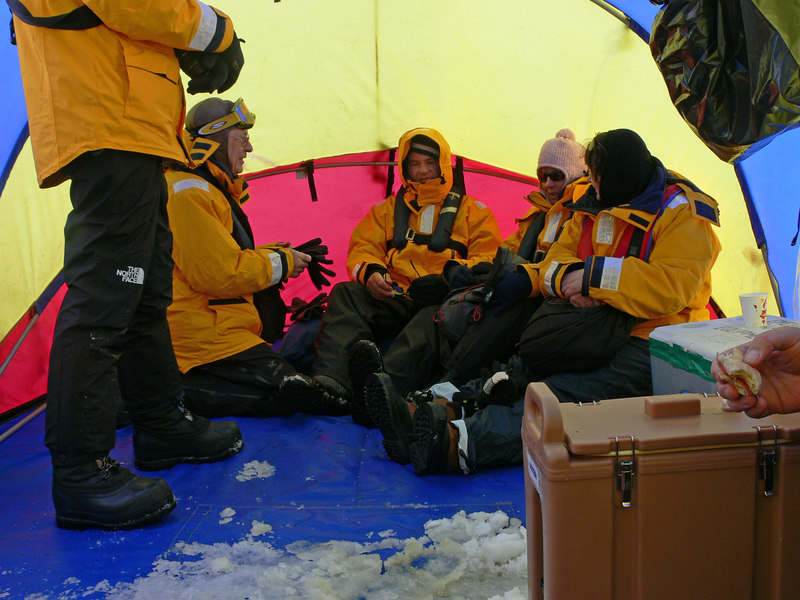 Inside the base camp tent getting warm and waiting for the helicopter