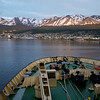 """Since our cabin was in the front of the ship, we were often awakened by """"ship sounds"""".  Around 4:00 AM on our last morning, David and I could tell we were nearing Ushuaia.  We watched the sunrise over the town before disembarking for the long trip home."""