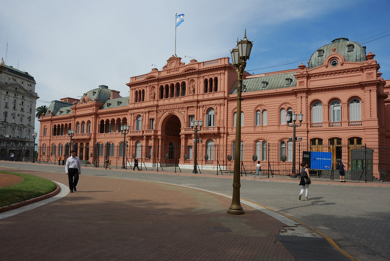 """After leaving the cemetary, we went on a city tour.  This is the famous """"pink palace"""" where Eva Peron made her speeches from the center balcony."""