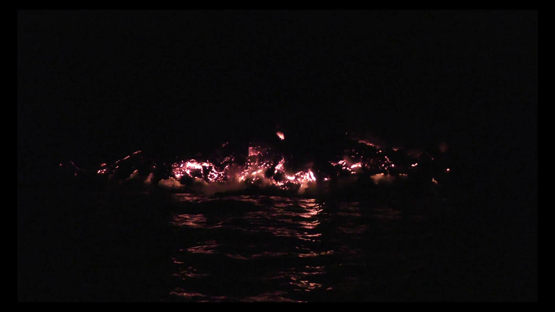 Short video which will give you a feel for what it's like to snorkel in front of an active lava flow.  The water temperature was interesting.... cold bands of ocean water alternated with hot-tub-temperature bands of warm water.  The sounds were incredible.  We did have the good sense to back up a bit when we saw and heard a particularly large piece of lava crash down into the ocean.
