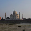 Near sunset, we crossed the Yamuna River to view the Taj Mahal from the opposite side of the river.  Even though the Taj Mahal is perfectly symmetrical (all four sides are identical), it has a different feel from beyond the river.