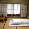"A lovely ryokan (traditional Japanese inn) was our home in Yamanouchi, the small town made famous by snow monkeys.  This was my room.  Amazingly, the ""bed"" was very comfortable, but climbing in and out was interesting :)  Note the height of the tables and chairs.... takes some getting used to."