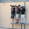 "These were my buddies.  All us ""tiny lens"" people huddled next to the school building while the ""giant lens"" folks were maybe 20 yards further out to get a flatter view into the nest."
