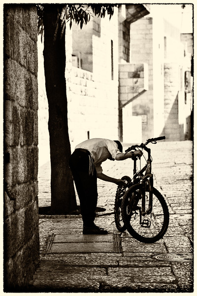 boy and his bicycle in the Old City - BW