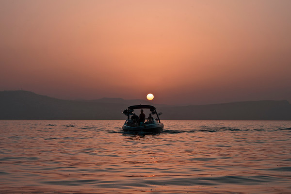 Pleasure boat at sunset on the Kinneret