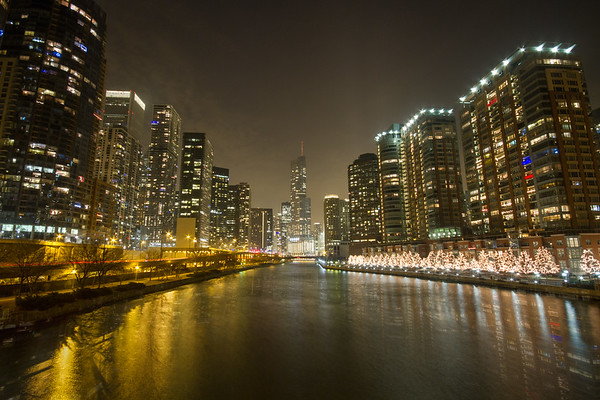 Buildings in Chicago on the river - at night with reflection on water - 2