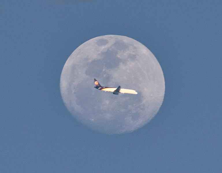 Plane in front of moon