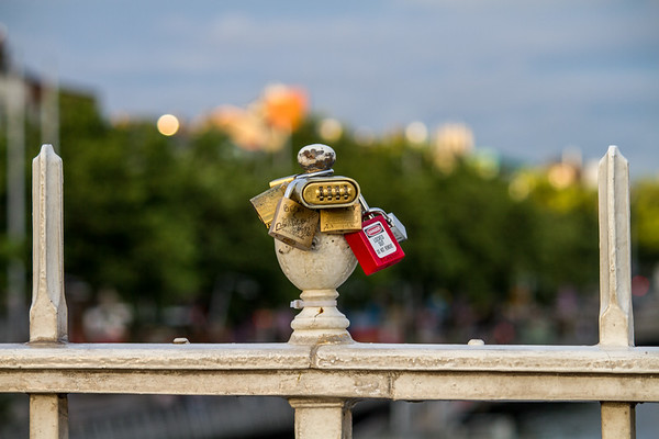 Dublin - Friendship Locks on a bridge over the Liffey River -  Bokeh background