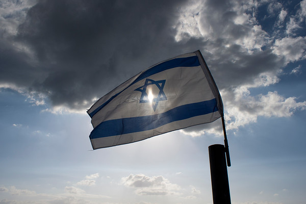 Sun shining through Israeli Flag