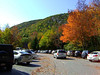 LEAF PEEPERS GALORE<br /> <br /> Here we are at Sieur de Monts -- named for Pierre Du Gua, de Monts, a French nobleman -- and the parking lot is packed. This is a very popular place at this very popular time of the year. In the background there is Dorr Mountain, named after George Dorr, the park's first superintendent.