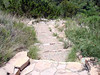 "ON THE TRAIL<br /> Notice the nice check work done here. A ""check"" is either a log or rock barrier set into the trail to hold back material, as seen here, although considering the steepness of the slope here, this is most likely ""cribbing"" which forms long steps. This trail was originally established by the Civilian Conservation Corps (CCC) in the 1930s, as you can tell by some of the fine rockwork along the way. Not all of the work is CCC, though, as Big Bend's trail crew does some nice work themselves. It's hard to tell which group did what."