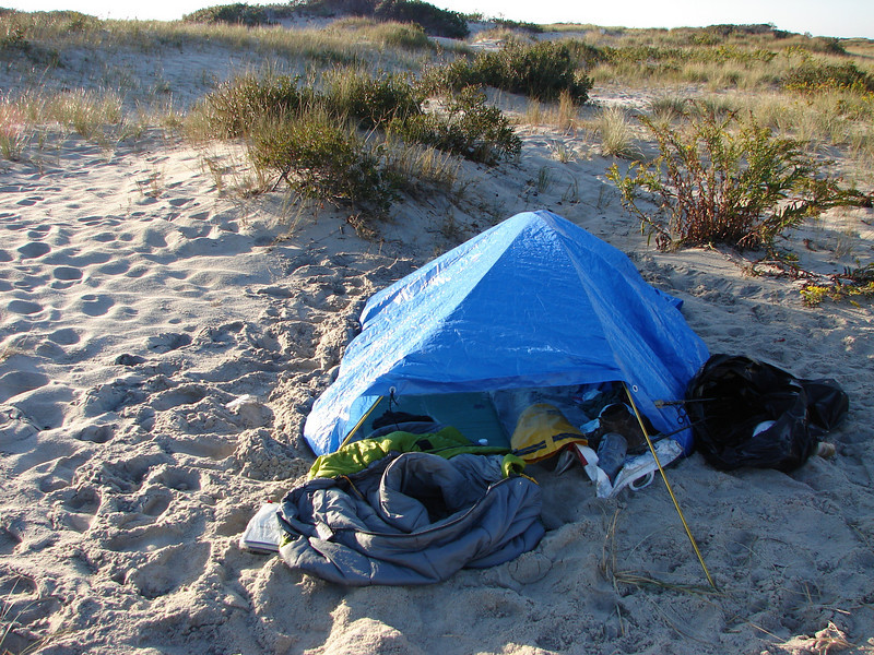Two tentpoles and a tarp, put up by a mildly hypothermic me, in the middle of a storm - Weathered the storm, and kept me warm and dry.