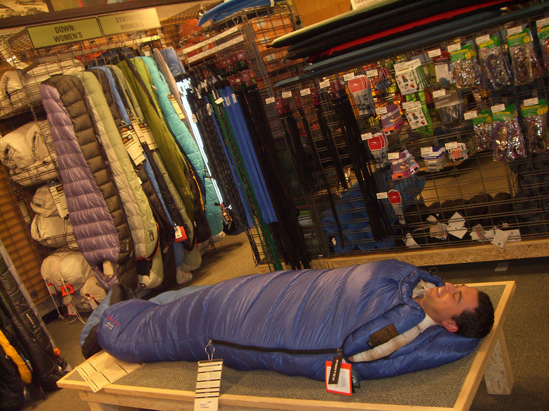 Benjy tests out his sleeping bag in the store.