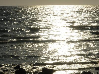 Sunset highlighting Gulf waters