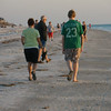Vadis and John walking Indian Rocks beach