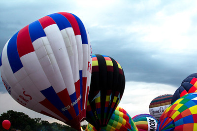 Trying to keep the balloons standing for balloon glow, September 16, Forest Park