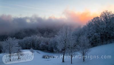 Sunrise over round mountain.