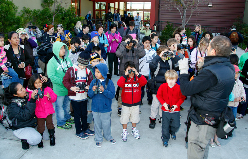 Juan Carlos Solis,right, Educational Director of Wildcare in San Rafael, gives instructions on how to properly use binoculars, distributed to the kids for the Winter Youth Bird Count, in the first educational collaboration of Audubon, PBRO and Wildcare at the Pickleweed Community Center in San Rafael, Calif. on Saturday, January 14,  2012.The warm weather brought three times as many participants as last year, with 51 children and 43 adults registering for the annual event that was conceived by Wendy Dalia, the Educational Director at  Richardson Bay Audubon Center and Sanctuary. (Special to the IJ/Jocelyn Knight)