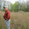Jim standing amidst a field of grey leaf dogwood - a good native species to have when trying to reclaim the fields for wildlife