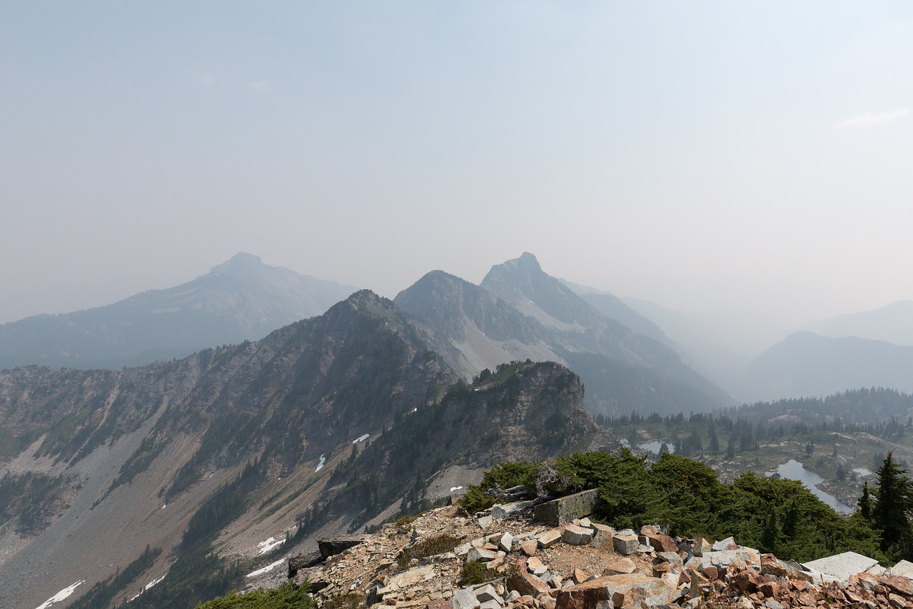 Looking generally Southeast back toward Hibox Mountain and Box Ridge. In the background is as much of Three Queens as you can see through all the smoke.