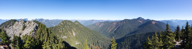~180 degree panorama from the Beckler Peak east summit. Left of the image is looking West toward the Central and West summits of Beckler Peak. Baring Mountain is in the background just right of the other Beckler summits. The tallest peak in the foreground on the right is Mount Fernow, which is Northwest of Beckler. Off in the distance Glacier Peak and Mount Baker are visible, along with a bunch of other Mountain Loop peaks.
