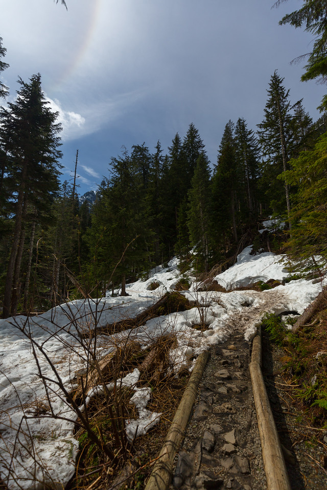 ~2300 feet elevation for this picture. Starting to see snow on the trail, and some ice crystals and rainbow overhead.