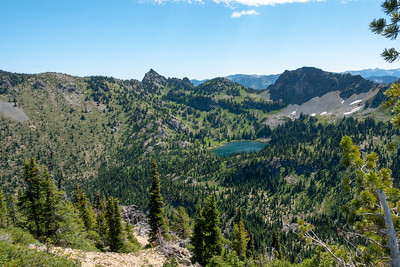 Crystal Peak summit. Looking east over Crystal Lake with Three-Way Peak and the Sourdough Gap behind it.