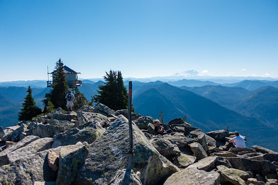 Summit marker, looking at the fire tower and Mt. Rainier