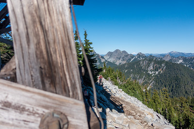 Granite Mountain fire tower with Glacier Peak in the background. Chair Peak surrounds Glacier Peak in the foreground.