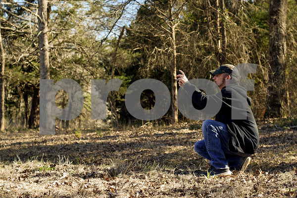 Brandon Holland takes a photo at Mrs. Lee's Daffodil Garden in Gladewater, Texas, on Tuesday, March 6, 2018. The original daffodils were brought in from Holland years ago and have continued to grow and thrive on the land. (Chelsea Purgahn/Tyler Morning Telegraph)
