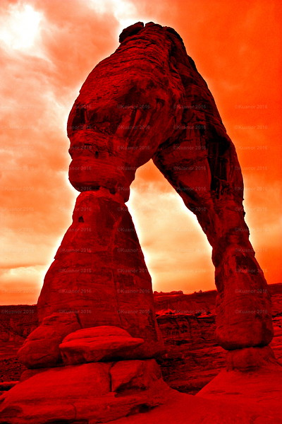Gate Of Gone<br /> Looking like the portal to Hell itself, the Delicate Arch in the Arches National Park in Utah, as seen through a red filter. You can perhaps see the devil's face on the side of the arch...