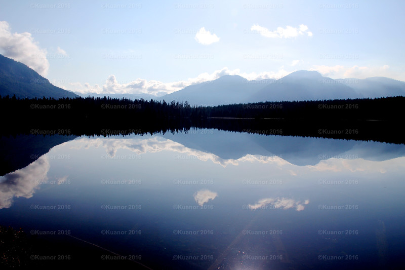 Bluestill<br /> As though carved in glass, this Hoomak Lake vista on Vancouver Island rests easy in the noonday sun